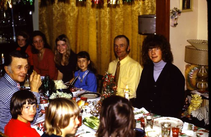 that's me in blue, and no surprise that I'm sitting between my sister, Pat, and my Dad.