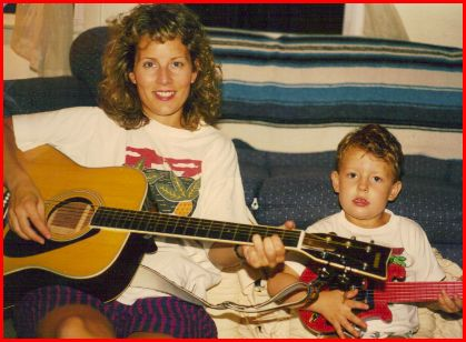 Youngest boy now has that guitar; an Emjayandthem (C) photo