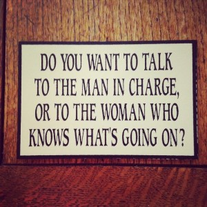man in charge or woman who knows whats going on